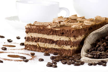 coffe beans: Tiramisu cake with bag of coffe beans and cup over white