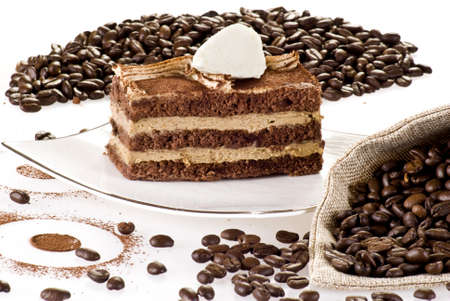coffe beans: Tiramisu cake on the plate with coffe beans around Stock Photo