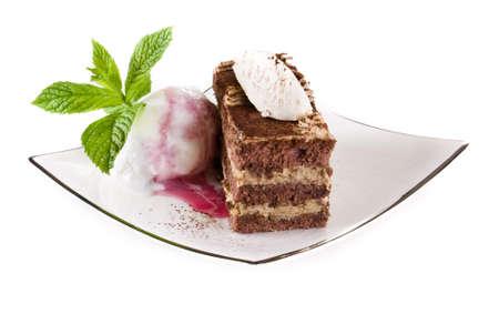tiramisu: Tiramisu cake on plate with ice cream isolated over white