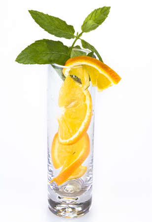 Slices of orange and mint in the glass isolated over white Stock Photo