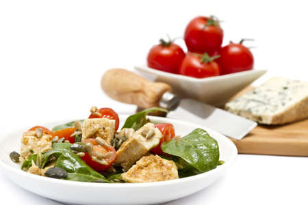 Spinach salad with chopping board of cheese and cherry tomatoes  photo