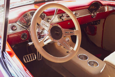 Red and tan leather interior of a classic car
