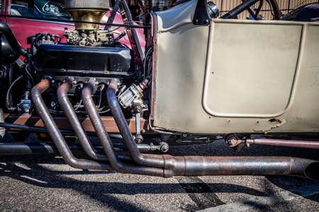 custom street rod showing header pipes