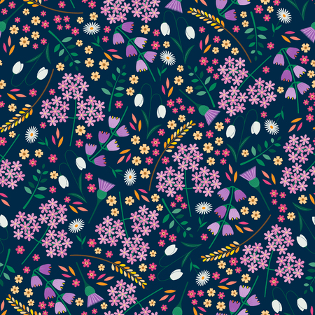Seamless tossed floral pattern with snowdrops, daisies, angelica, bluebells and thistles on a dark blue background
