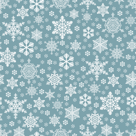 Seamless densely packed white snowflakes pattern on a blue background