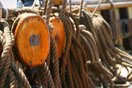 nautical pulleys with ropes on the deck of a ship old photo