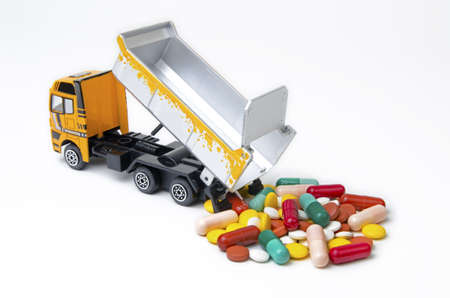 medical distribution: Drugs downloading truck of many colors and shapes