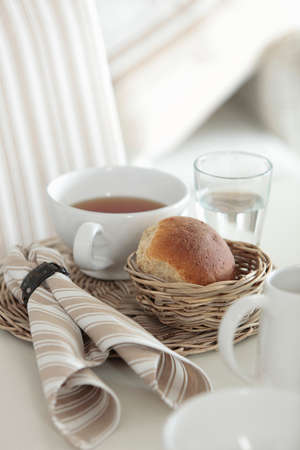Teacup with bread. Imagens