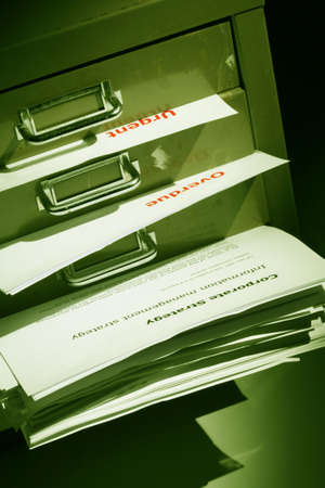 bulging: documents and files bulging out of a filling cabinet Stock Photo
