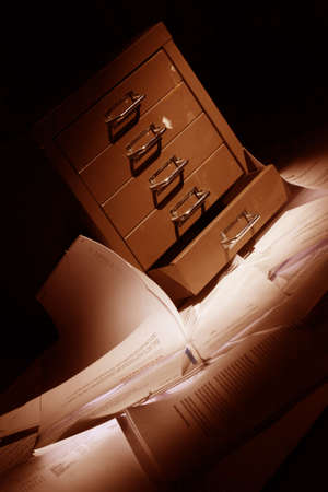 archival: filling cabinet with documents all over the floor
