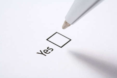 tickbox: form with a ticked yes tickbox and pen Stock Photo