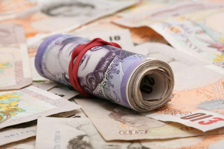 heap of role: Role of twenty English pound notes on ten pound notes Stock Photo