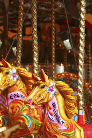 fairground: Fairground horses on a merry-go-round, bright colors