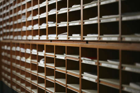 filing system: organised journals in pigeonholes in a library, concepts, order, organised, old filing system.