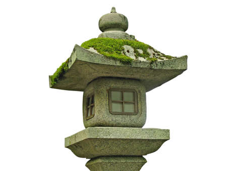 A Japanese stone lantern covered with moss and isolated on white photo
