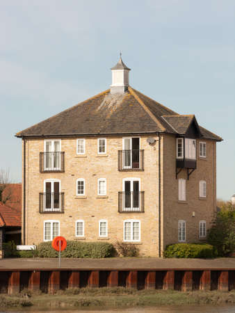 end of the trail: A block of flats on the River Colne at Rowhedge. Stock Photo