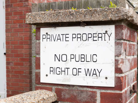 inform information: a public sign outside on a brick wall saying private property no public way of right white and back council law Stock Photo