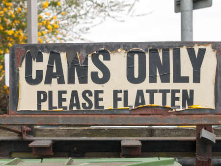 paint container: a tattered outside sign at recycling plant and bins saying cans only please flatten retro vintage cool chic bottles signs public