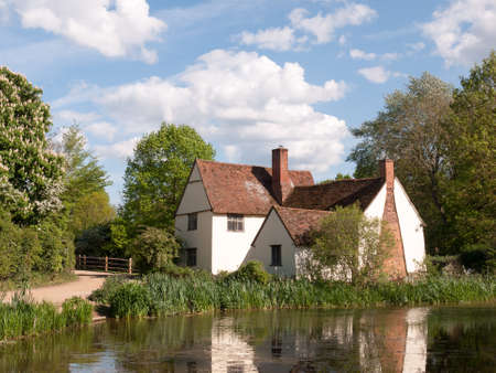 willy: Willy Lotts Cottage outside in flatford mill in constable country old and famous location building from a painting on a summer afternoon with no people very beautiful
