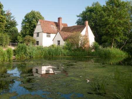 willy: Willy Lotts cottage and river front on a clear sunny day; Suffolk; UK Stock Photo