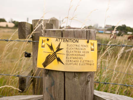 A Safety Sign on Farm Electric Fence; Essex; UK Stock Photo