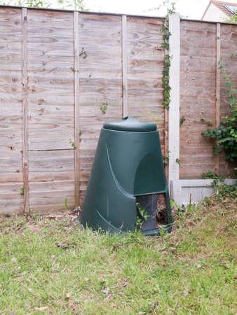 a green compost bin outside in garden; Essex; UK