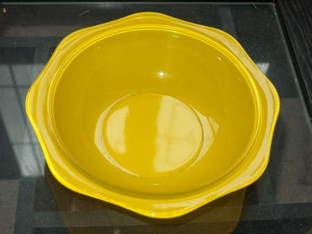 a yellow empty bowl sitting on table; England; UK