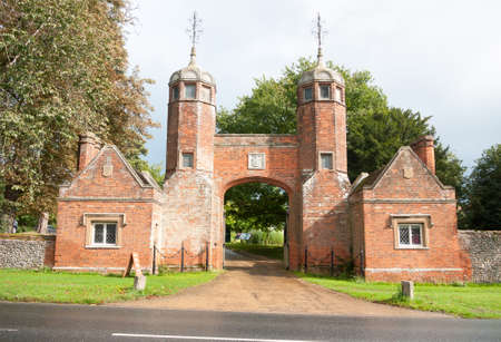 old english: big open entrance to fancy mansion estate long melford melford hall suffolk; England; UK Stock Photo