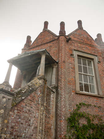 old english: close up of small built outhouse mansion manor; England; UK Stock Photo