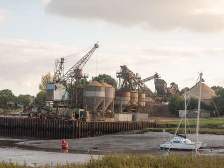heavy industry: sand industry materials quarry dock factory across river; England; Essex