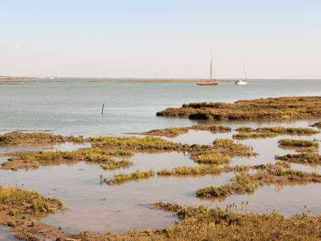 marshland coastal scene essex tollesbury estuary boats in river sea; essex; england; UK Stock Photo