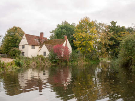 willy: willy lotts cottage in flatford mill during the autumn no people; Suffolk; England; UK Stock Photo