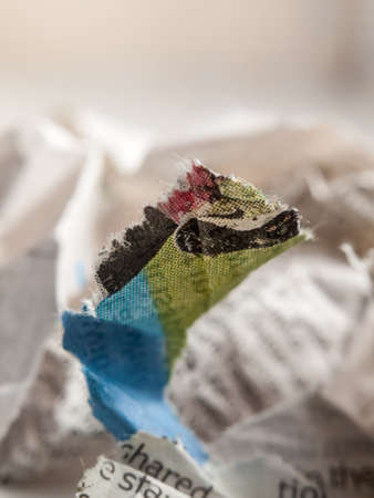 eye ball: close up of crumpled up newspaper studio macro; essex; england; uk