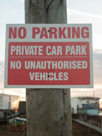 No parking private car park no authorized vehicles sign on post close up; west Mersea, Essex, England, UK Stock Photo