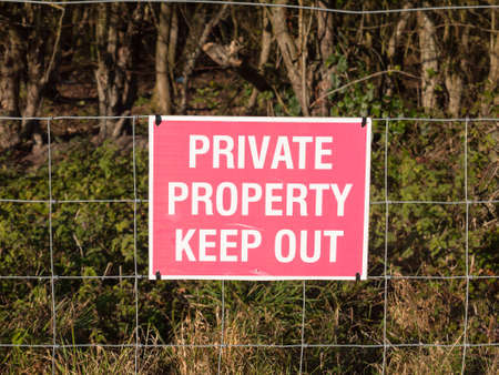 close up of red and white country sign private property keep out; essex; england; uk Stock Photo