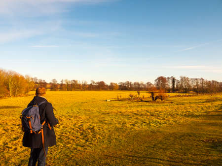 rambling through countryside field person from behind blue sky ; essex; england; uk Stock Photo
