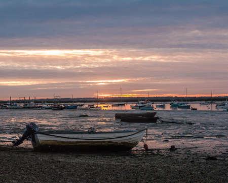 coastal boats beach sun set scene special nature background sky; essex; england; uk