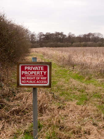 red wooden private property sign farm land no right of way no public access; essex; england; uk