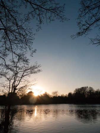 lake surface outside sunset nature landscape background; essex; england; uk