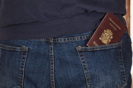 closeup of passport in back pocket of man