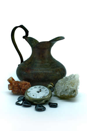 aragonite: Old vase, pocket watch and gemstones Stock Photo