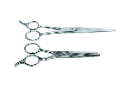 tapering: Special scissors for work of hairdresser on white