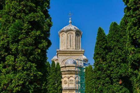 restauration: Tower of Curtea de Arges Monastery under restauration Stock Photo