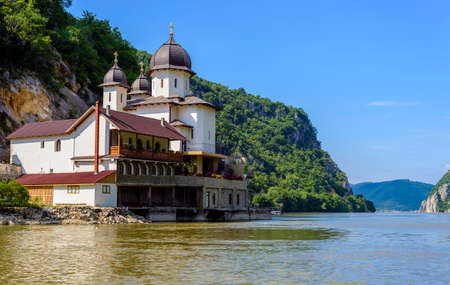 "Mraconia Monastery is the only Romanian monastery built between the rocky banck of the Danube and its waters. Mraconia means ""hidden place"" or ""dark water"". It is located 15 Km west of the Romanian town Orsova"