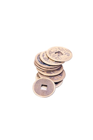 A stack of old chinese coins isolated on white background Stock Photo