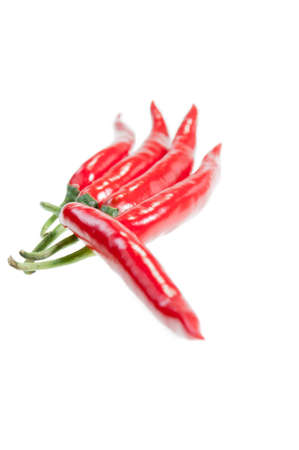 Five red chilies pointing at two directions  photo