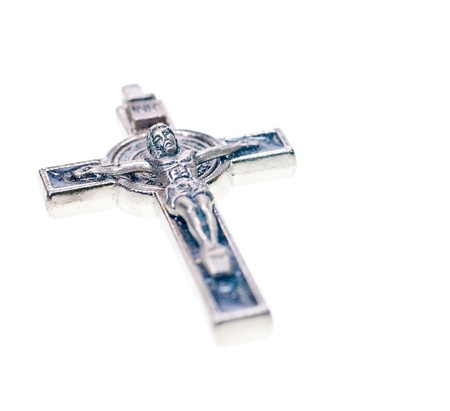 crucification: A metal Crucifix close up close up on white background