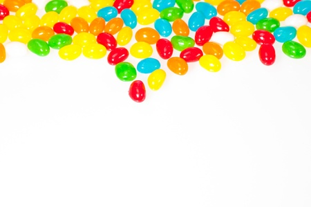 Gummy: Colourful jelly beans border isolated on white background