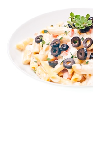 Penne with vegetable cream sauce and black olives is another great Italian traditional pasta dish photo