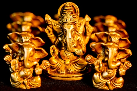 The Hindu God Ganesha surrounded amongst Ganesha's photo